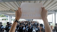 Thousands of Hong Kong protesters gather, government offices shut after violence