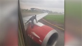Man Climbs Onto Wing of Plane As It Prepares for Take Off