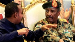 Head of Sudan's military council sworn in as head of new sovereign council