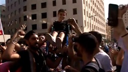 Watch: Protesters carry child in wheelchair in Riad el-Solh