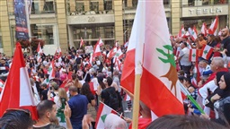 Scores of Lebanese join in a demonstration in Sydney in support of their fellow Lebanese citizens