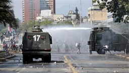 Chilean state of emergency extended around country after at least seven die in riots