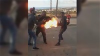 Watch: Group of men prevent their friend from setting himself on fire