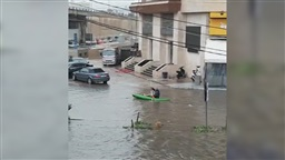 Watch: Kayaker rows down flooded street in Beirut