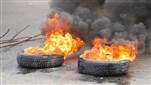 Watch: Protesters block road with burning tires