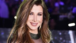 Nancy Ajram to Information Minister: You reflect the image of the Lebanese woman we are proud of