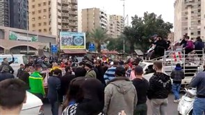Protesters gather in Tripoli's Abdel-Hamid Karami Square, young men hurl stones at Tripoli Serail