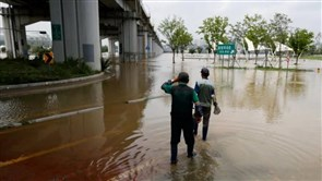 South Korea floods, landslides kill 14
