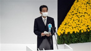Japan's Abe, on WW2 anniversary, vows not to repeat war, sends offering to shrine
