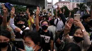 Thais defy protest ban for sixth day with 'Hunger Games' salutes