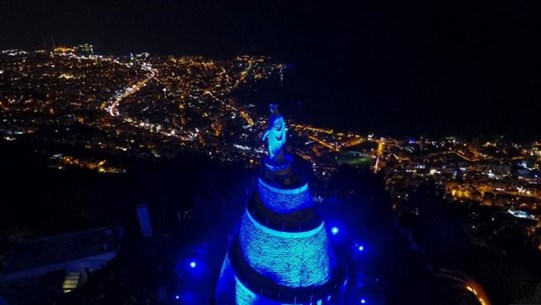 Lady of Lebanon Harissa lit up in blue on World Autism Day