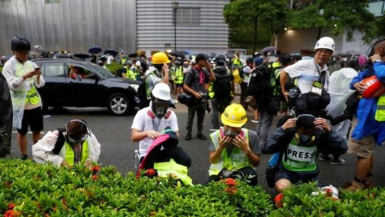 Hong Kong police again use tear gas to try to disperse protesters