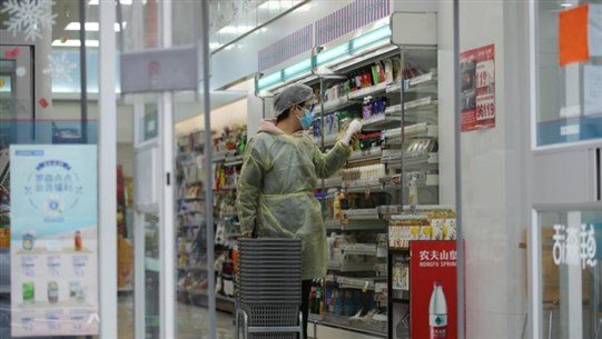 Coronavirus may be over soon in China, expert says, as WHO warns of global threat
