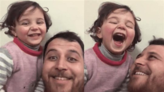 Syrian father, protecting daughter from trauma, turns sounds of war into a game