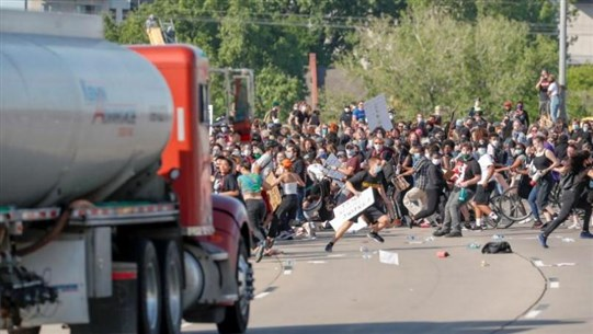 Truck drives into protesters on Minneapolis highway